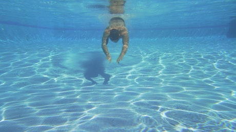 Swimming underwater in a pool