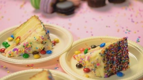 Table of a birthday party with cake