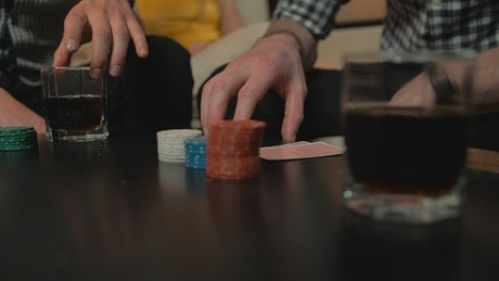 Table while young people play poker