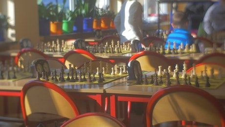 Tables with chess board games