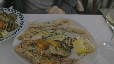 Taking a photo of seafood