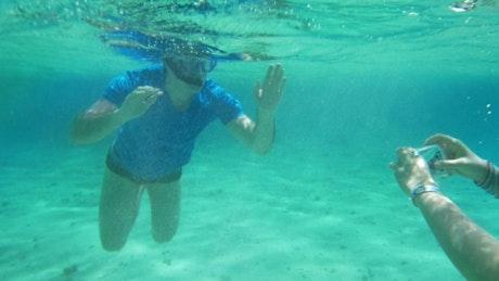Taking a photo underwater