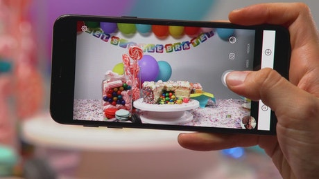 Taking a picture of a birthday table with a smartphone
