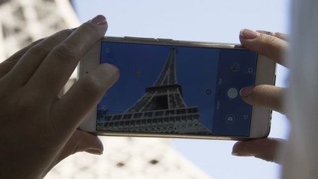Taking a picture of the Eiffel tower close up