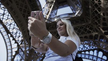 Taking a selfie under the Eiffel tower