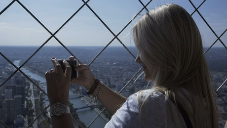 Taking photos at the top of the Eiffel tower