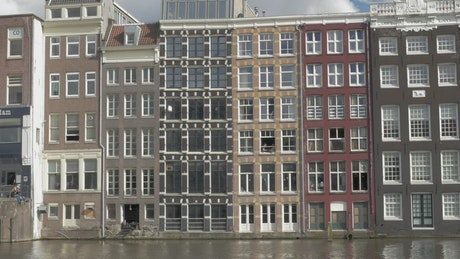 Tall houses along a river