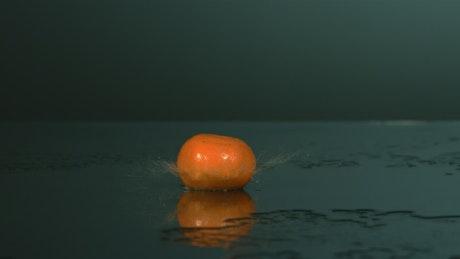 Tangerines bouncing and splashing water