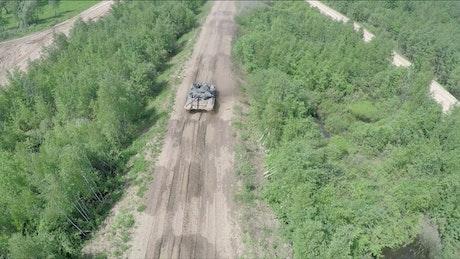 Tank driving over rough terrain