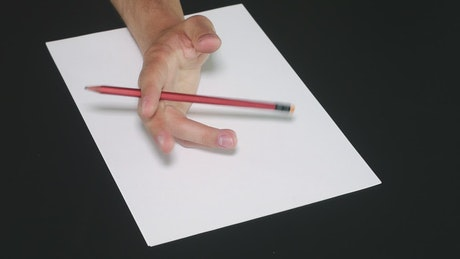 Tapping a pencil against the page