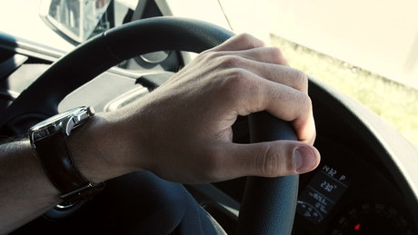 Tapping on a steering wheel
