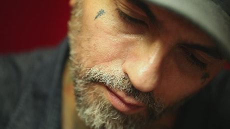 Tattoo artist doing a tattoo to a client