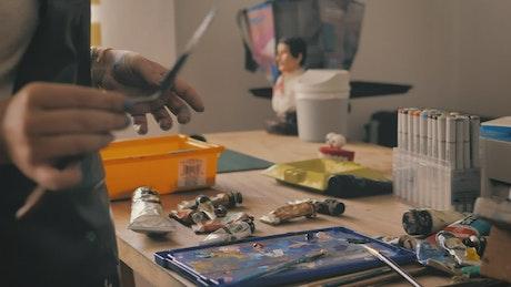 Tattooed artist applying paint