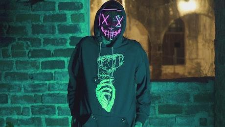 Tattooed man wearing a scary mask