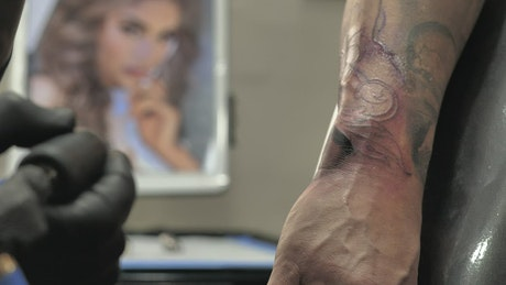 Tattooing a forearm