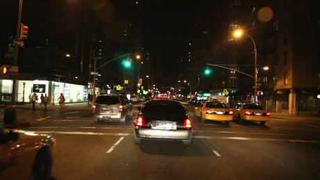 Taxis driving through the streets at night