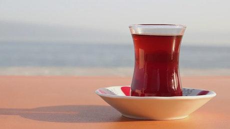 Tea glass near the beach