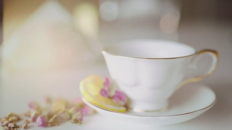 Tea poured into classic china tea cup with flowers