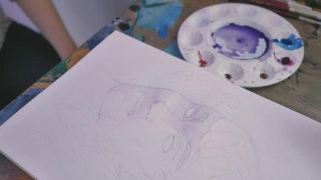 Teacher advising a painting student