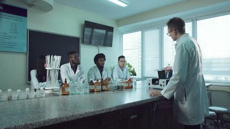 Teacher explaining chemistry to students