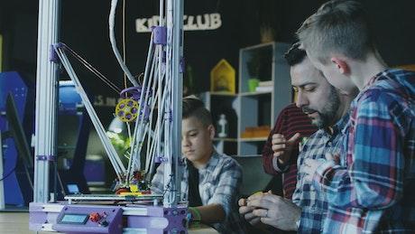 Teacher explaining how 3-D printing works