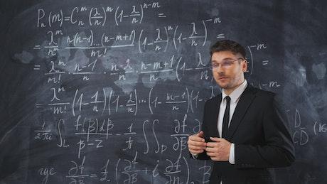 Teacher explaining mathematical formulas