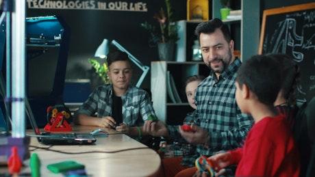 Teacher explaining to kids 3-D technology