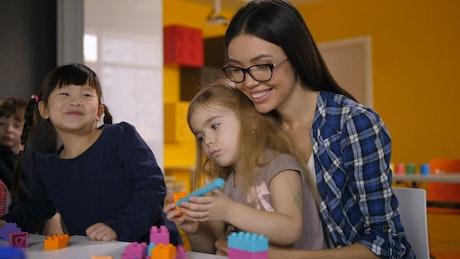 Teacher guiding her students