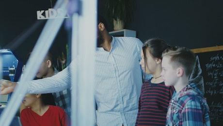 Teacher showing teeth to children