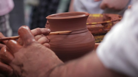 Teaching a child to craft clay pots