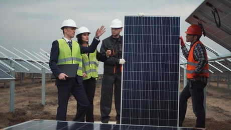 Team of engineers working with solar panels