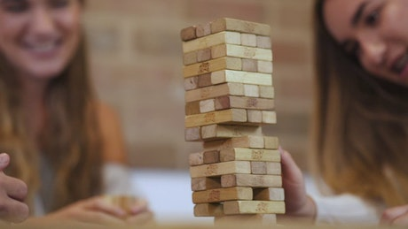 Tearing down a Jenga tower in a fun match