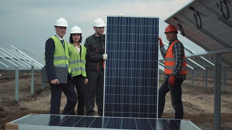 Technical team with solar panel