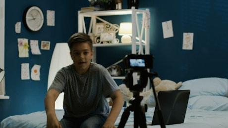 Teen boy filming himself in the bedroom