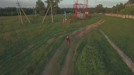 Teen riding a bike in the country