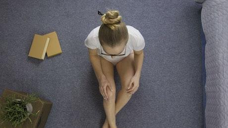 Teenager meditating at home