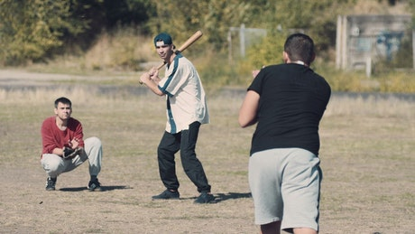 Teens practicing baseball in the park