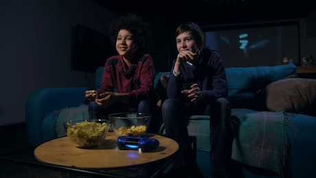 Teens watching a funny film together