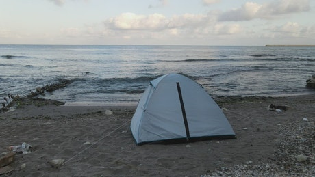 Tent at the edge of the sea on a beach