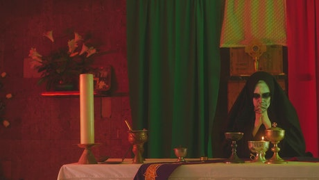 Terrifying ghost nun praying in a temple
