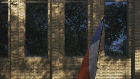 Texas flag waving on a building wall