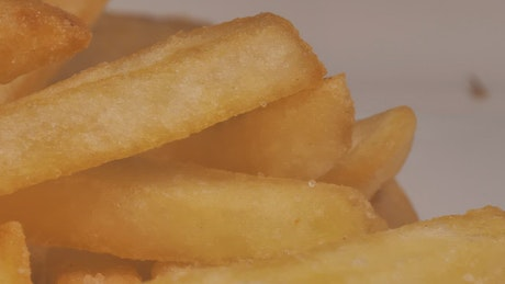 Texture of french fries with ketchup, macro close up
