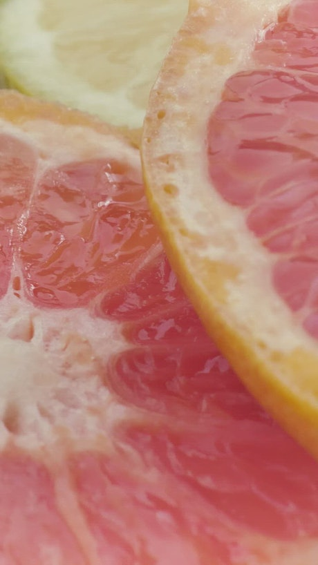 Texture of fresh grapefruit slices
