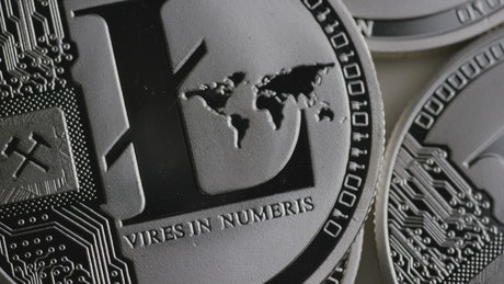 Texture of silver Litecoin coins slowly rotating