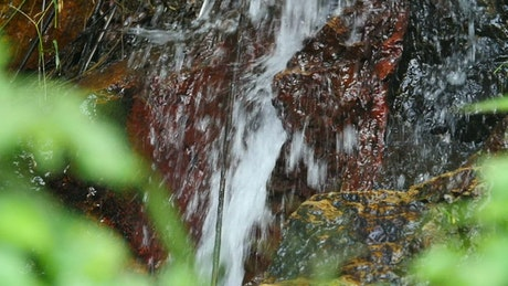 Texture of water tumbling down rocks