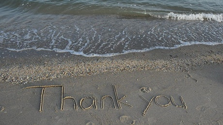 """Thank you"" on the beach"