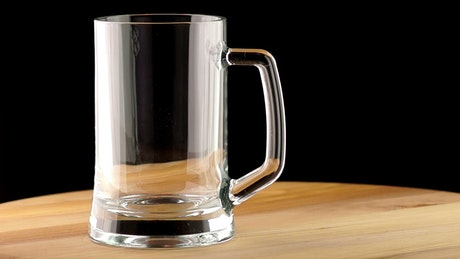 The beer poured into a mug