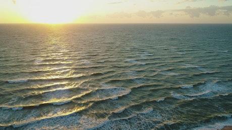 The calm sea at dawn on the seashore