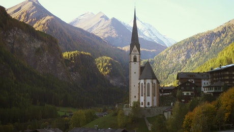 The church tower and mountain landscape