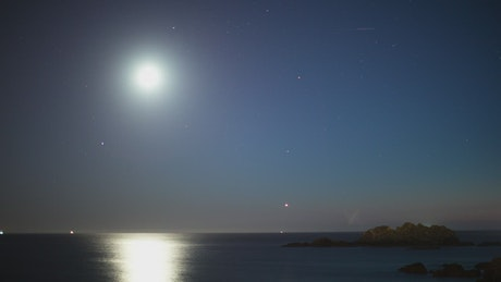 The moon and the stars at sea